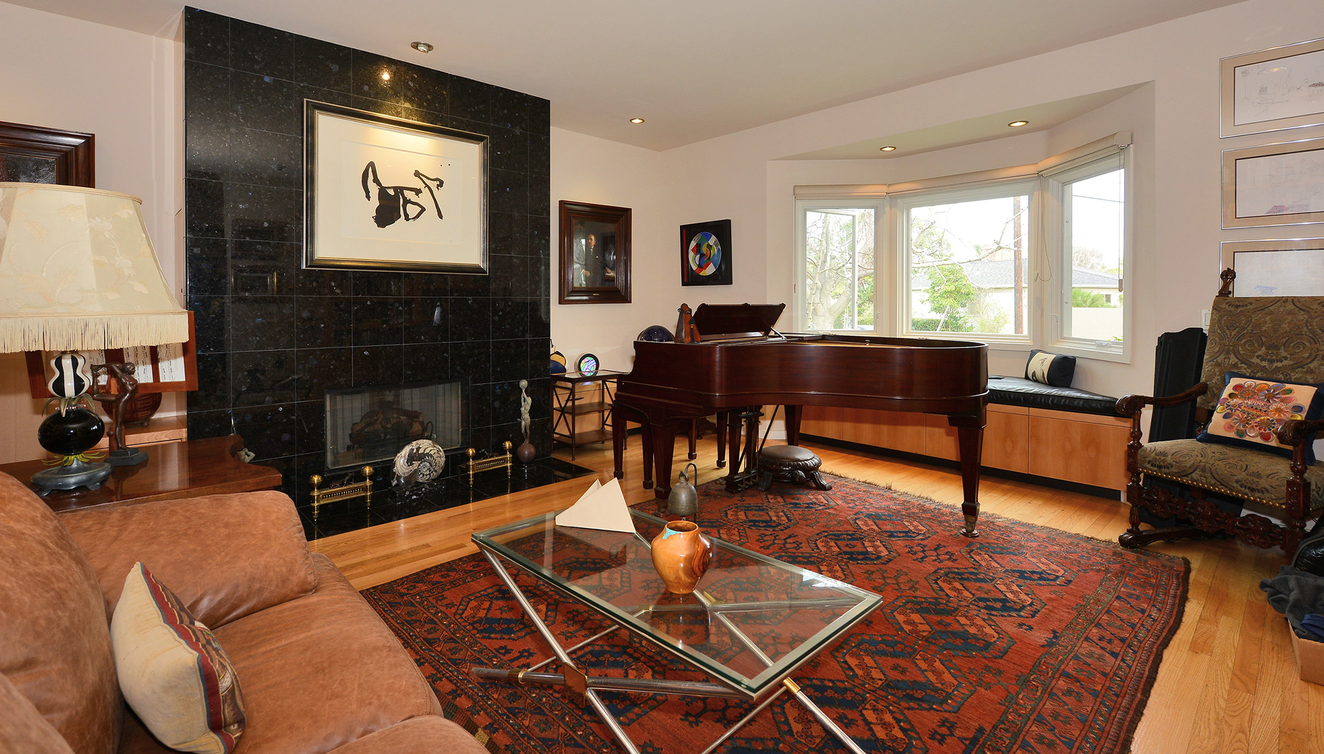 Baby Grand in Living Room with black fireplace Peteris Architects Residential Designs